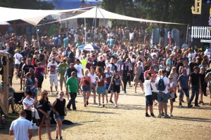 People walking around on Roskilde Festivalsquare